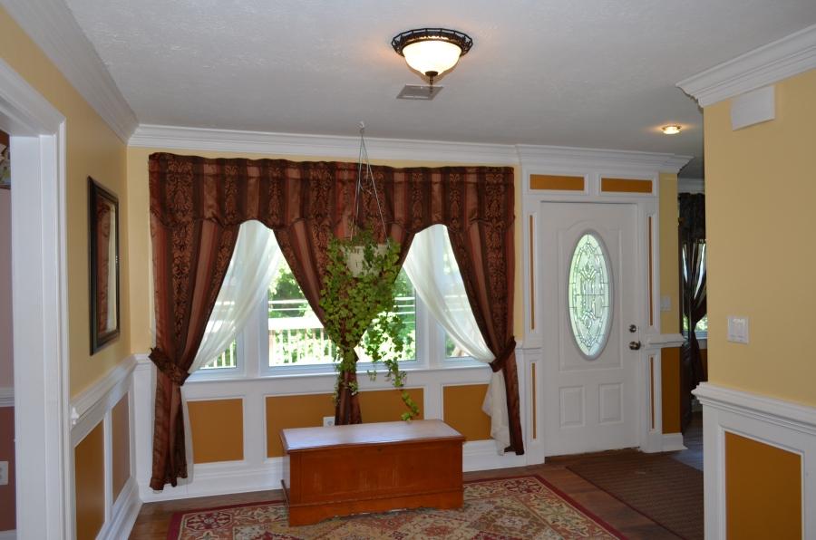 Entry foyer with hardwood floors