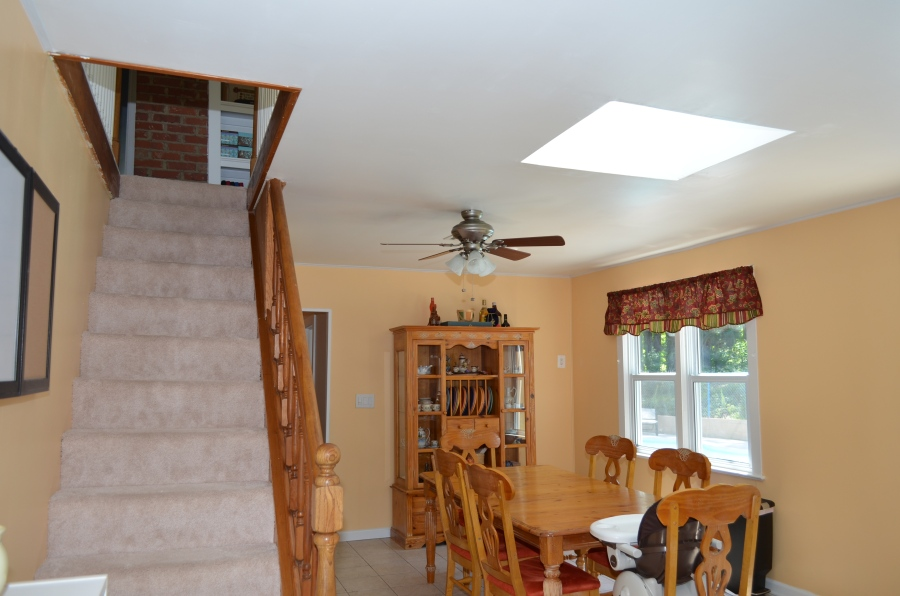 Kitchen informal dining area, and stairway to second level teen suite.