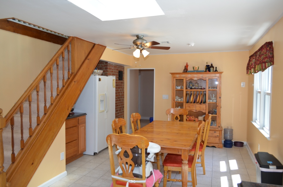 The second kitchen entry leads to the master bedroom, main level bathroom (full), and second bedroom.