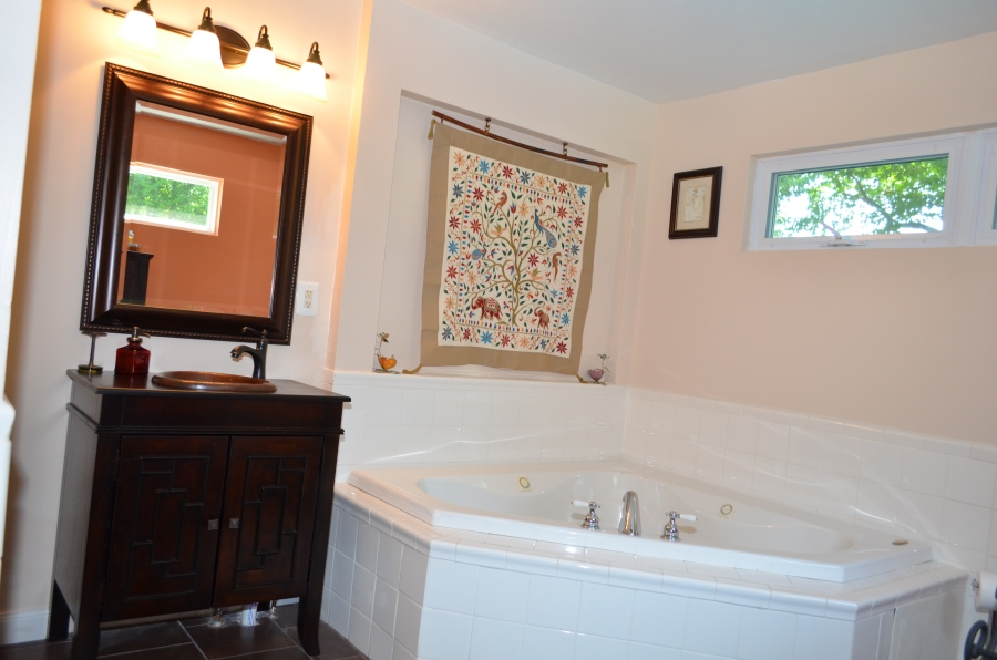 Soaking tub and vanity in the master bathroom.