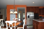 Gourmet kitchen with gas cook top, side-by-side refrigerator, microwave, and double oven.