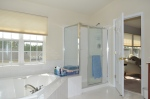 Master bathroom with separate shower and soaking bathtub at 5500 Silver Leaf Lane Fredericksburg, Virginia.