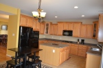 The kitchen includes level 2 appliance upgrades & Corian counters.
